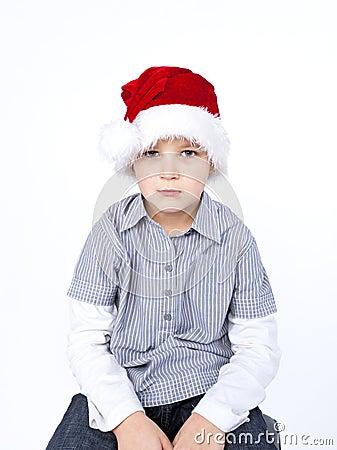 Sad boy in red hat