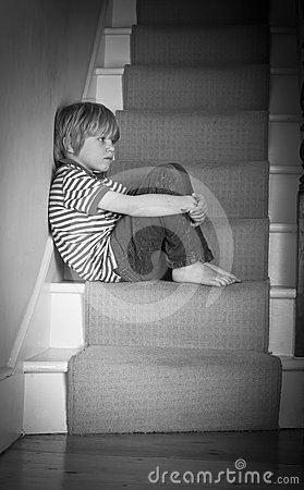 Sad boy on the stairs
