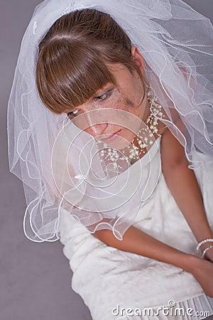 Sad bride on the ground