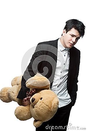 Sad businessman holding big soft toy