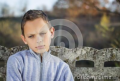 Sad child looking down