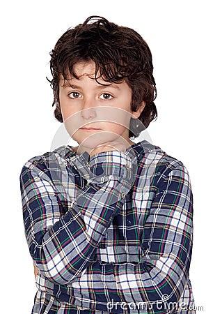 Sad child with plaid t-shirt