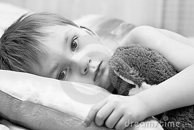 Sad child with a teddy bear