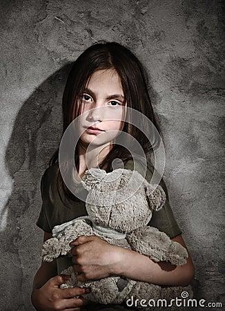 Sad child with toy