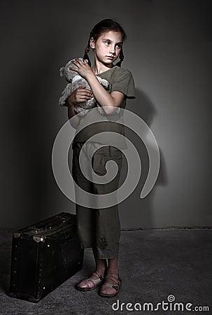 Free Sad Child With Suitcase Royalty Free Stock Image - 14704956