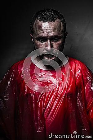 Sad concept, man with red plastic