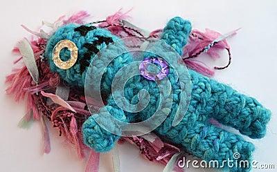 Sad crochet doll with scar