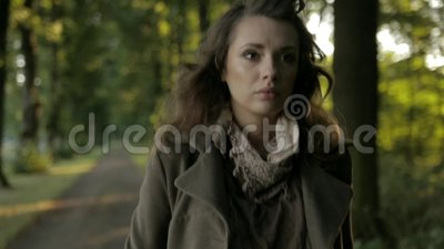 Sad and crying woman. Young miserable woman in the park