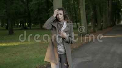 Sad and crying woman. Young miserable woman in the park stock video