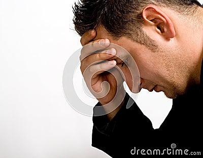 Sad depressed young businessman