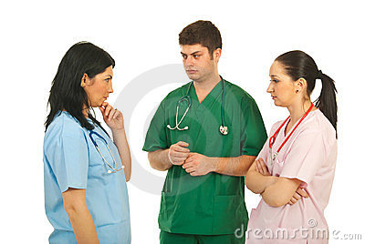 Sad doctors having conversation