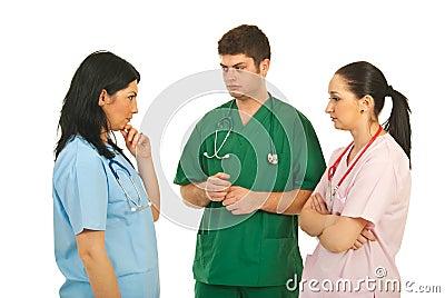 Sad doctors having conversation