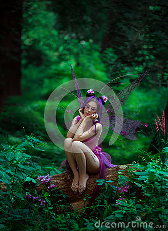 Free Sad Fairy Sitting On A Tree Stock Photo - 75258730