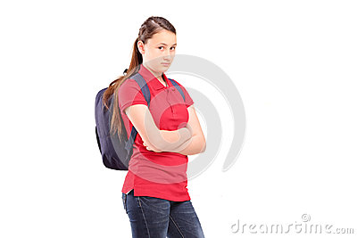 A sad female teenager with a backpack