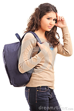 Sad female teenager with bag on her back posing