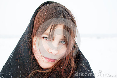 Sad girl in a black headscarf