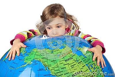 Sad girl embracing big inflatable globe
