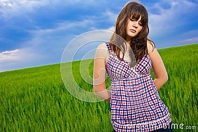 Sad girl in field
