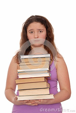 Sad girl holds  stack of books.
