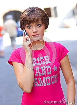 Sad girl with mobile phone
