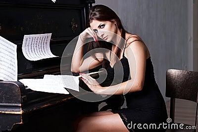 Sad girl near piano