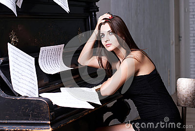 Sad girl near piano