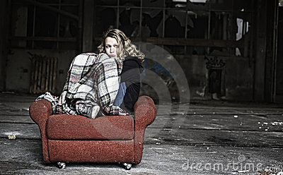 Sad girl in shabby sofa