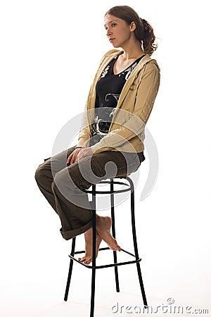 Free Sad Girl Sits On Stool Royalty Free Stock Image - 2891456