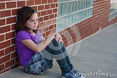 Sad girl on street