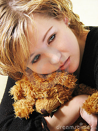 Sad girl with a teddy bear