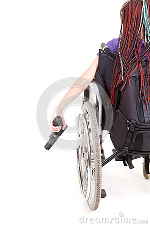 Sad girl on wheelchair with gun