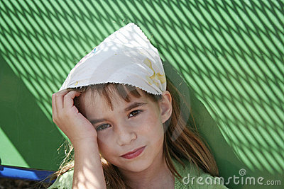 Sad little girl with green background