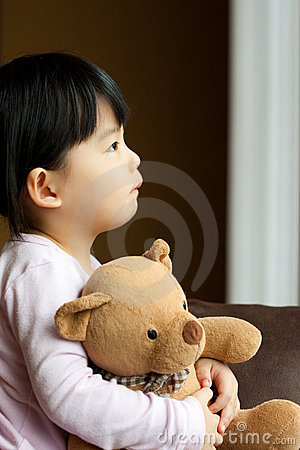 Free Sad Little Girl With Teddy Bear Stock Photography - 13894142