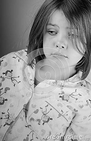 Sad Looking Child in Pyjamas