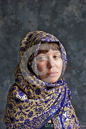 Sad looking woman wrapped in shawl