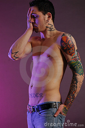 Stock Photo: Sad male with tattoos
