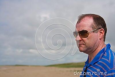 Sad man on the beach