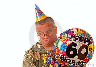 Sad man holding a balloon for a 60th birthday part