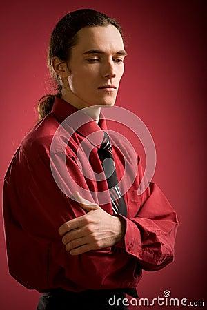Sad man in red shirt