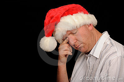 Sad man in Santa hat