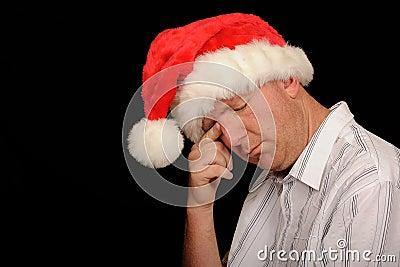 Sad man in Santa hat