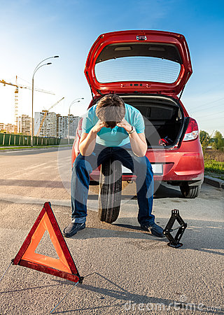 Free Sad Man Sitting On Spare Wheel Near Broken Car Stock Images - 40246294