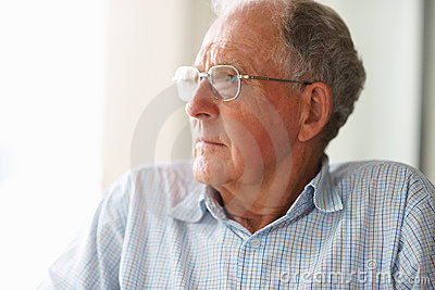 Sad old man looking away in thought