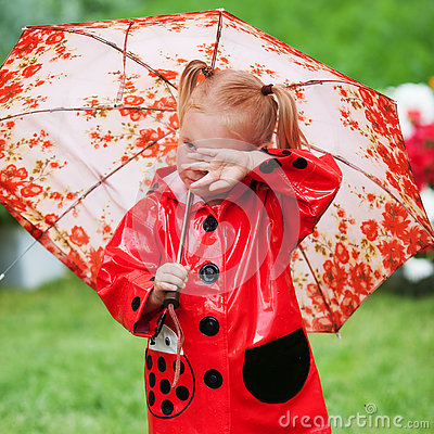 Free Sad Pretty Little Girl In Red Raincoat With Umbrella Walking In Park Summer Stock Photo - 78054870