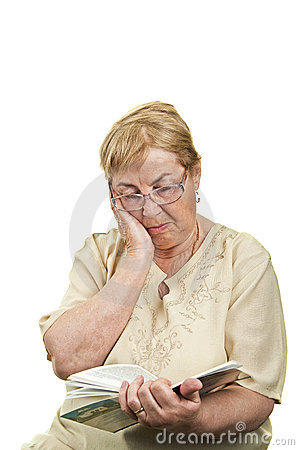 Sad senior woman reading head leaning on hand