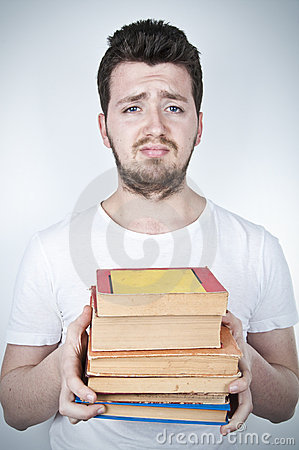 Sad student holding books