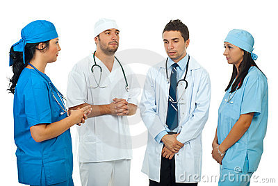 Sad  team doctors have a  discussion