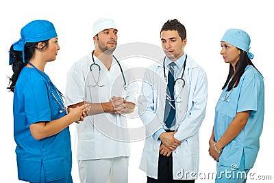 Sad  team doctors have a  discussion