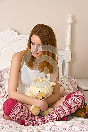 Sad teen on bed