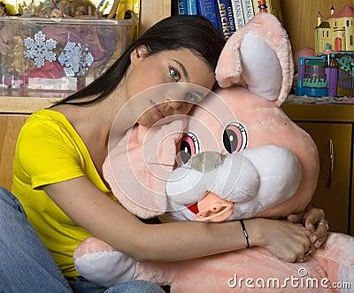 Sad teen girl with bunny toy